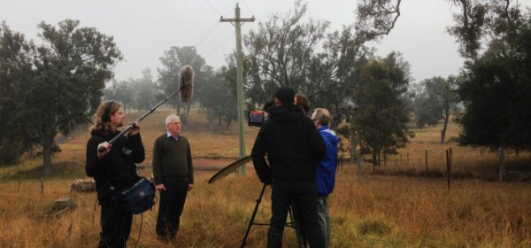 Glenbrook based Film makers in a field making a film