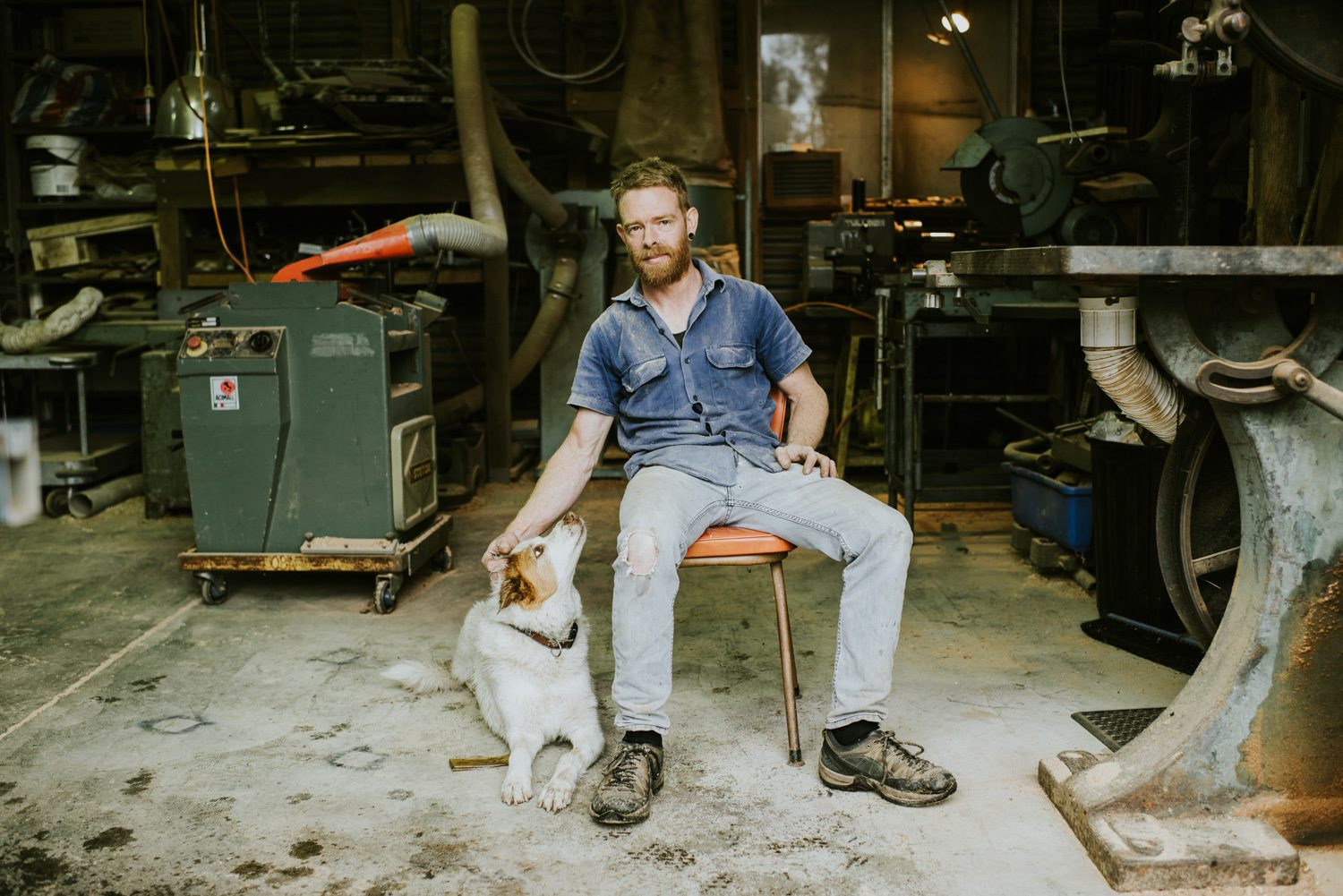 Michael Hoffman and his dog in his Blue Mountains studio