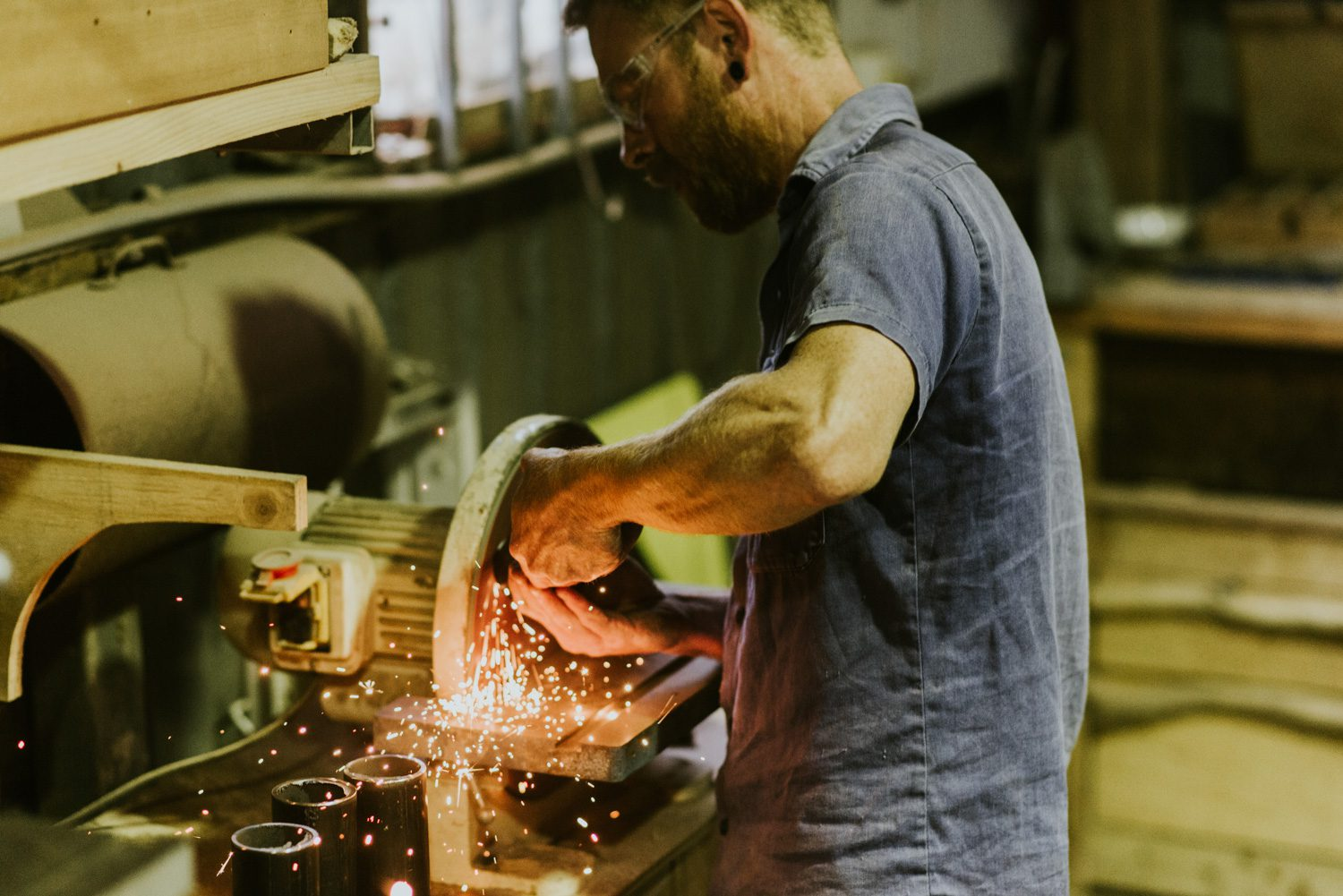 Michael Hoffman using the sander in his Blue Mountains studio