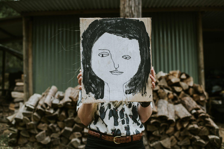 Emma Magenta holding portrait