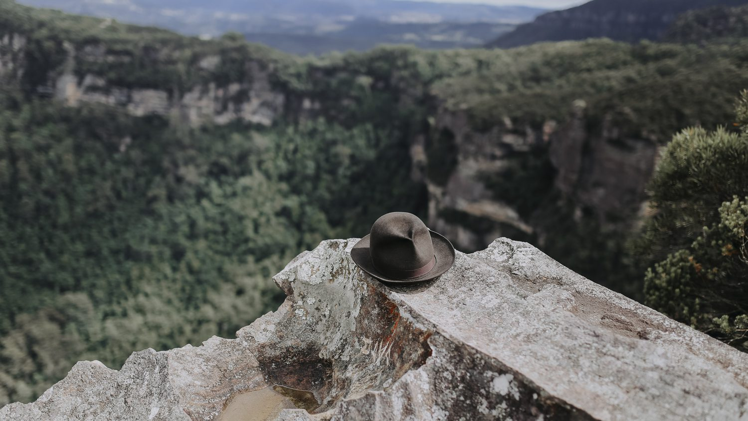 Justin Hunter musician hat on rock